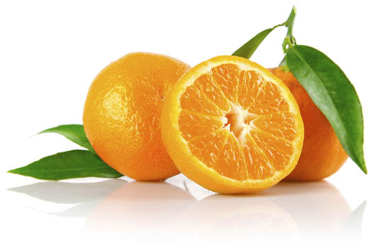 A photo of three vibrant oranges, one cut open into half.