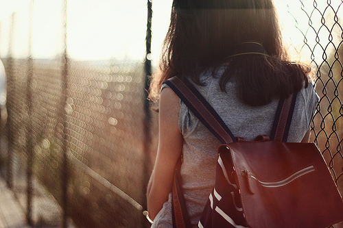 Girl walking in the warm afternoon haze