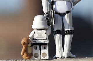 Stormtrooper kid with parent and teddy