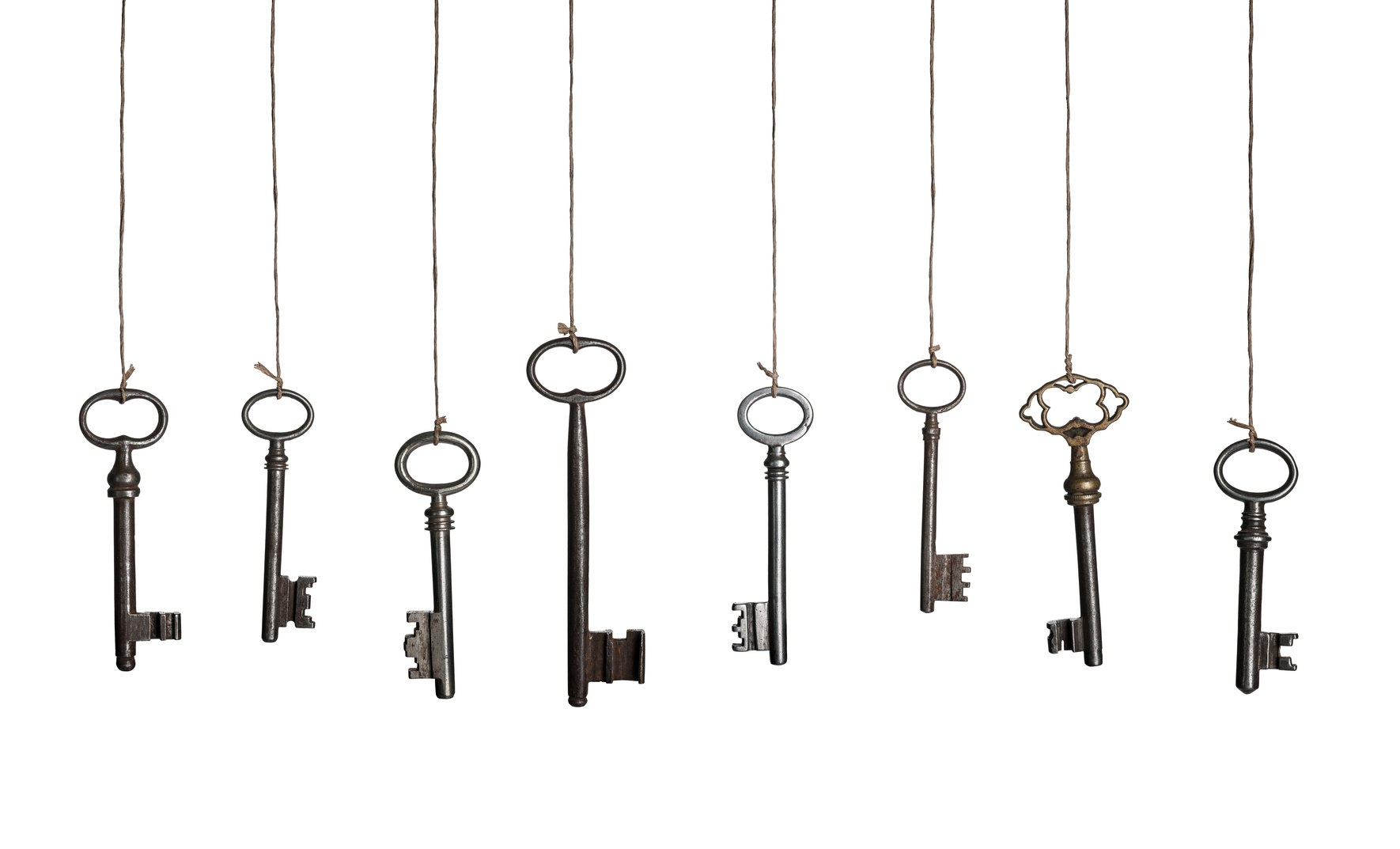 Picture of keys hanging on strings
