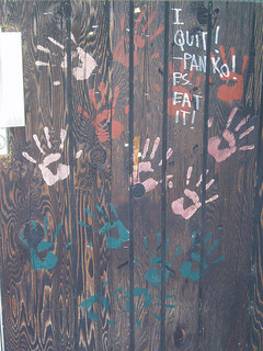 Colored handprints on a fence - evidence of past users?