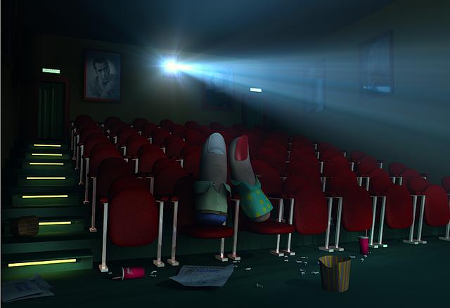 Two friends enjoying a movie.