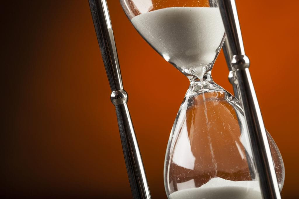 An hourglass with sand pouring through