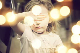 Little girl hides her eyes