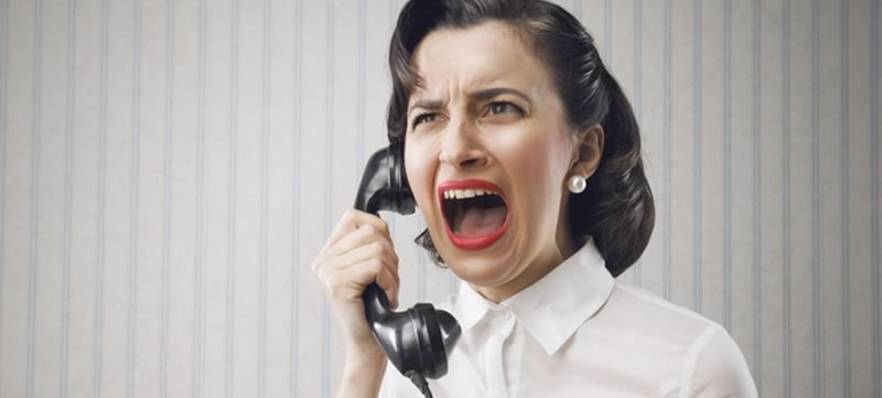Stressed out woman on old fashioned phone