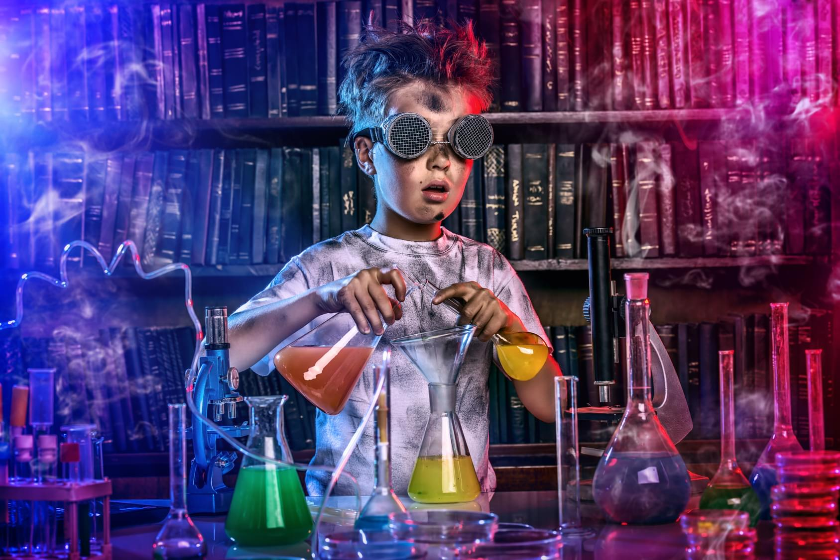A boy doing experiments in the laboratory. Explosion in the laboratory.