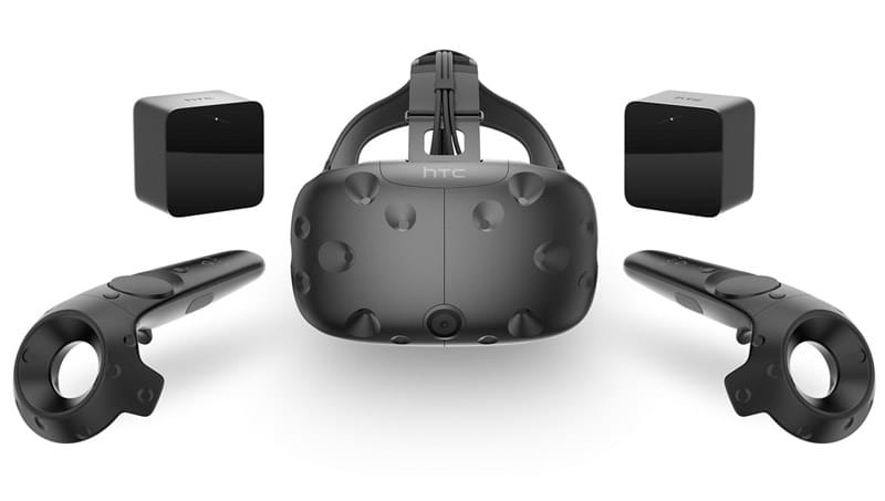 The HTC Vive headset with its Lighthouse sensors and controllers