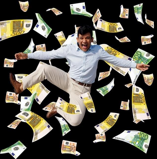 Financial freedom: a man rolling in money